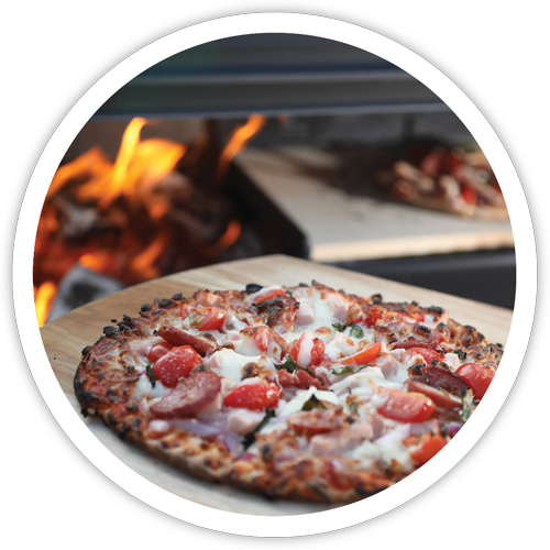 pizza cooked by outdoor fire place